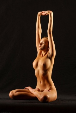 Yoga Full Lotus Pose with Overhead Arm Stretch